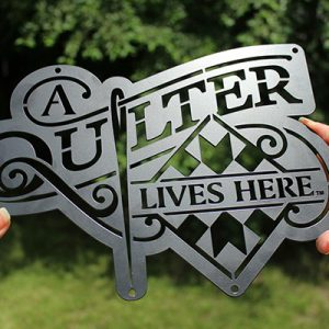 03-Joe-Diaz-A-Quilter-Lives-Here-Logo-Metal-Cut-Sign